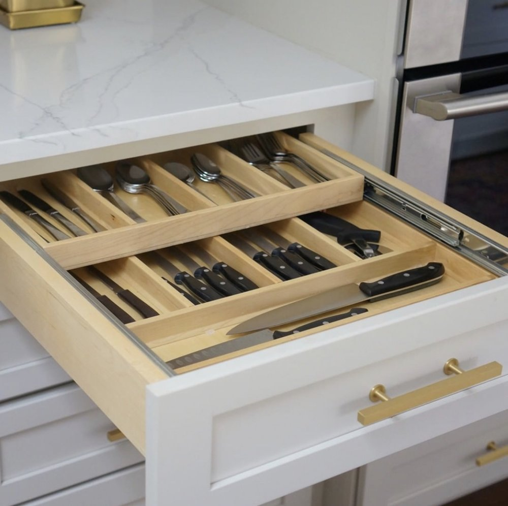 Silverware and knives organized in dual pull out drawers