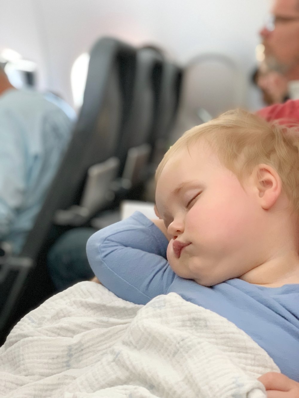 baby sleeping on an airplane