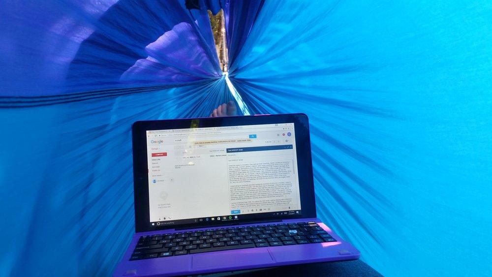purple hammock with purple computer laptop tablet digital nomad