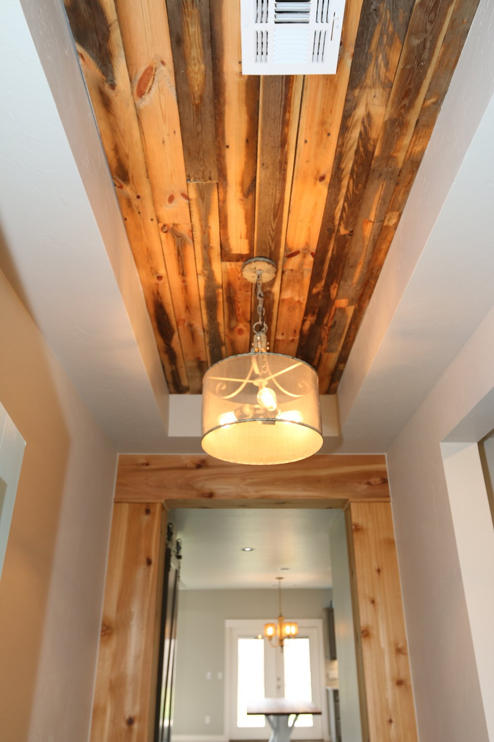 reclaimed wood walls and ceiling with chandelier.jpeg