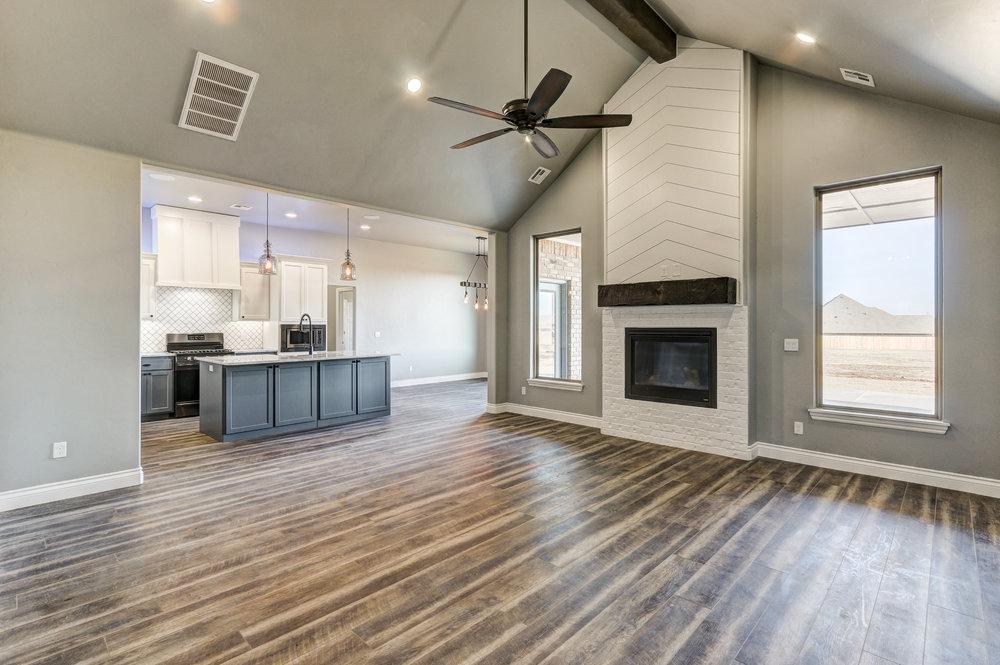 Custom Interior Piedmont, Oklahoma wood floors, fire place, modern rustic.jpg