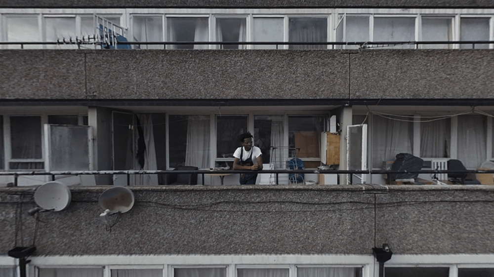 One of the contributors and residents Anthony Badu on the balcony of his Aylesbury estate flat.