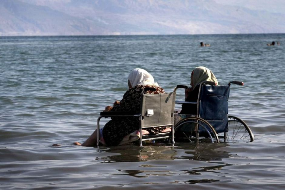 Elderly Palestinian ladies sit in wheelchairs as they enjoy the waters of the northern part of the Dead Sea, in the West Bank, October 2, 2008 by Menahem Kahana