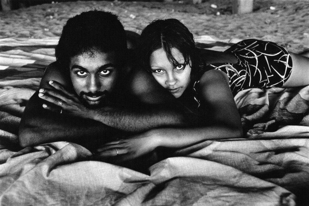 Couple Under the Boardwalk by Arlene Gottfried