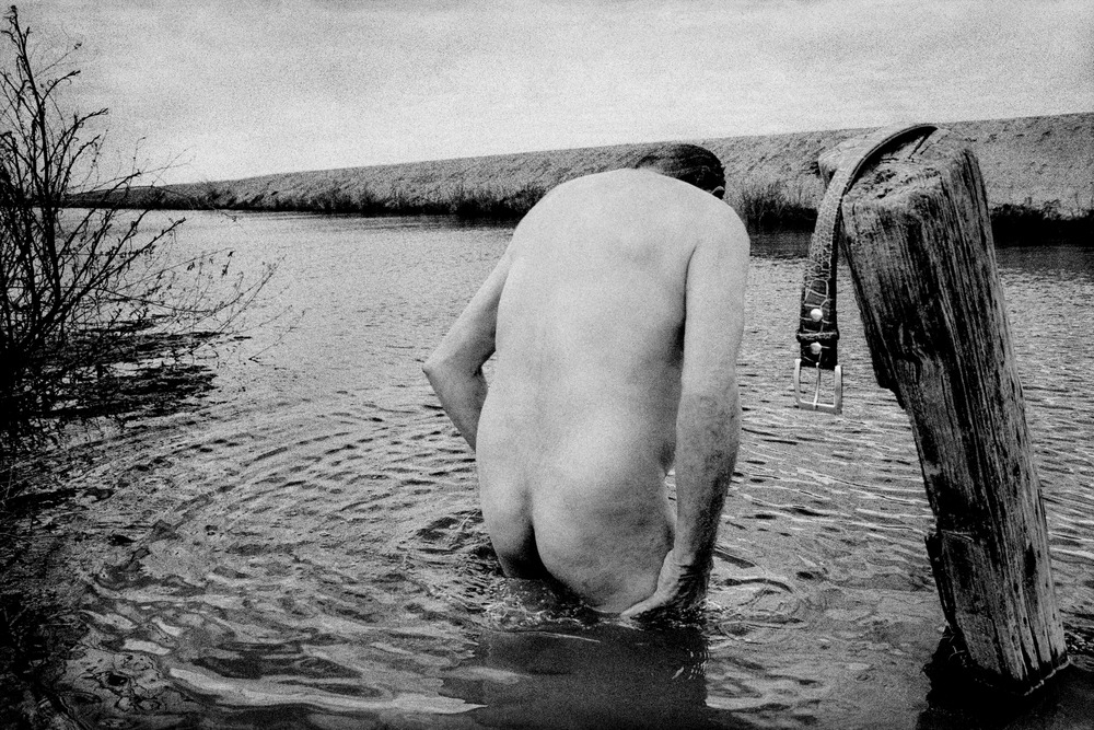 Homeless Man Bathes in a Ditch. Mendota, California, by Matt Black.jpg
