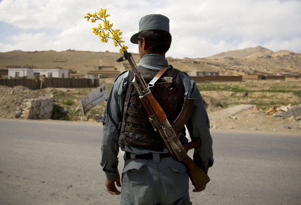 An Afghan National Police officer at a checkpoint in the outskirts of Maidan Shahr, Wardak province, Afghanistan, May 15, 2013.
