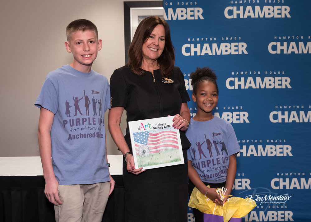 Karen Pence with military children presenting her with a gift.