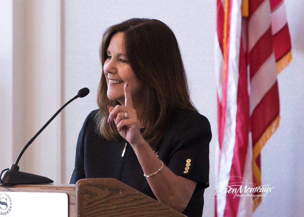 Image of Karen Pence addressing the audience at a Comfort Crew event.