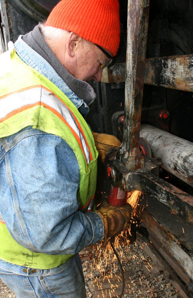 Bill A grinding welds off pins..JPG