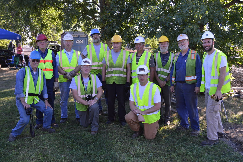 The site team, ready for the lift in Waterville. Back Row Standing (L-R): Myron Moody, Bill Alexander, Bob DeWachter, Ron Jenkins, Joe Foley, Paul van Steenberghe, Leverett Fernald, Peter Violette. Front Row Kneeling (L-R): Collie Moody, Richard Glueck, Tom Audet. Missing: Al Jenkins, Shawn Melvin, Dale Lehoux.  (Photo by Kerri Marion)