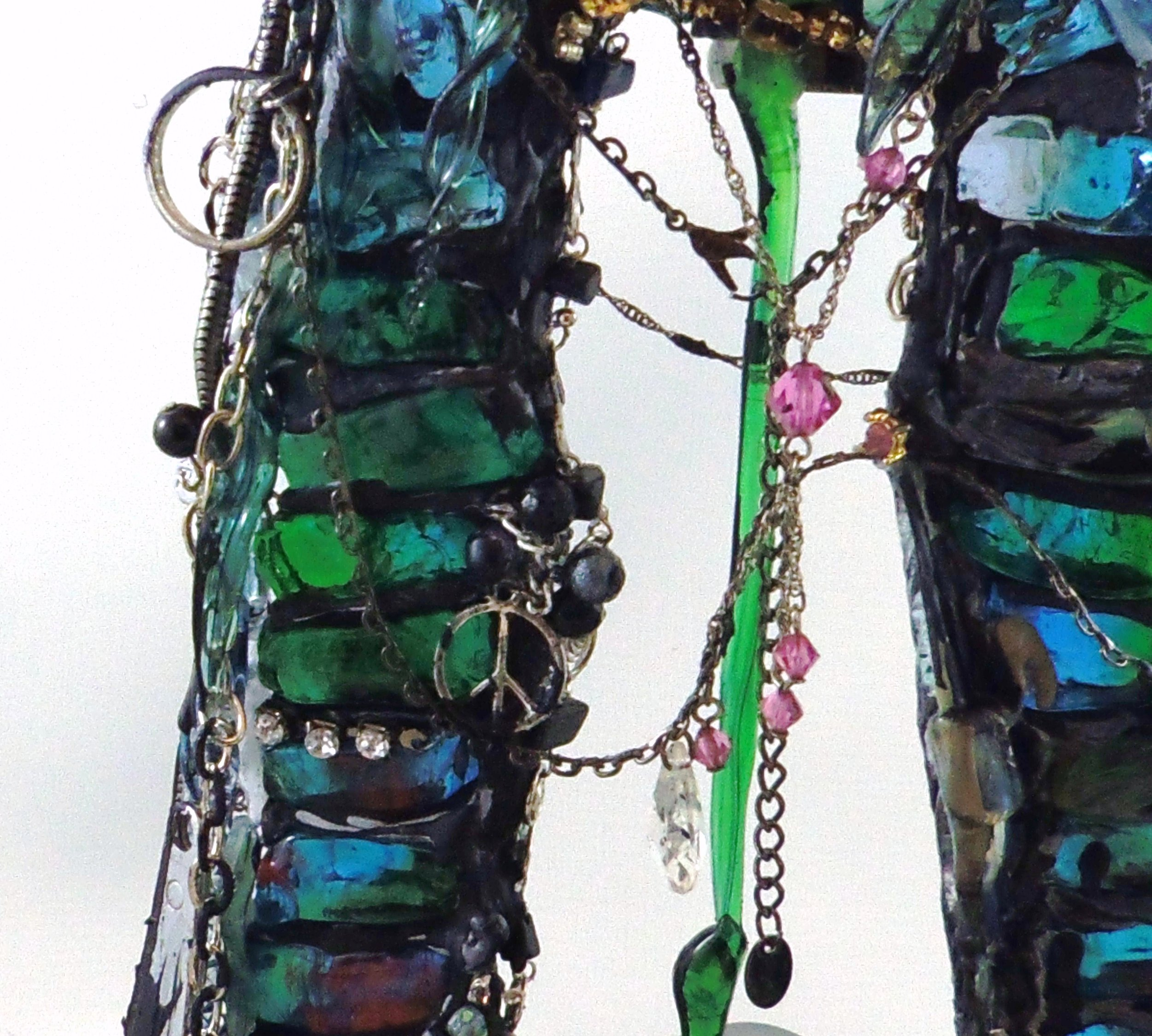 Doorway sculpture made of lampworked glass and found objects