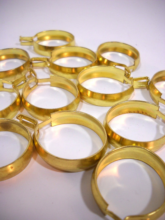brass curtain rings circa 1960