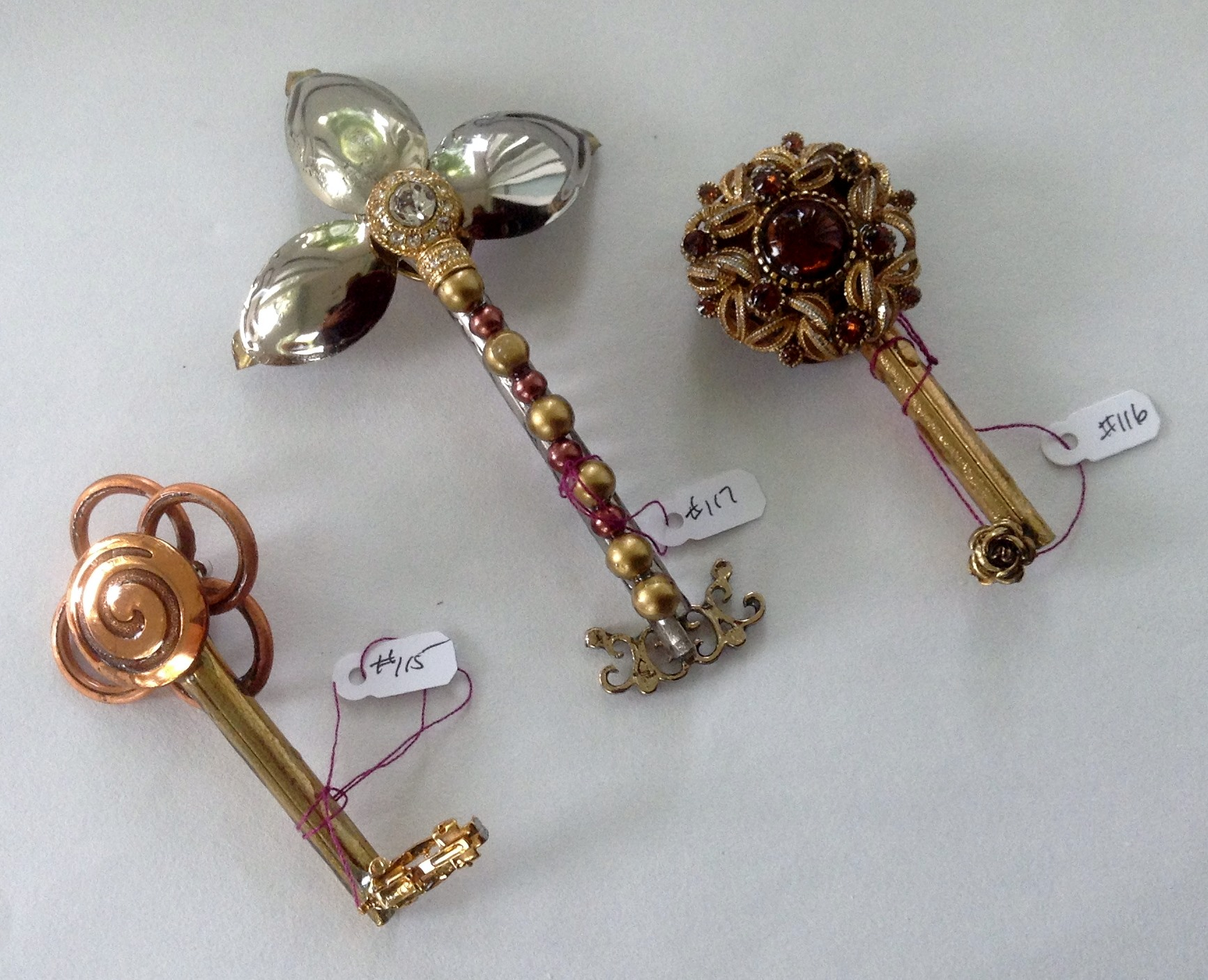 one side keys 115, 116, 117