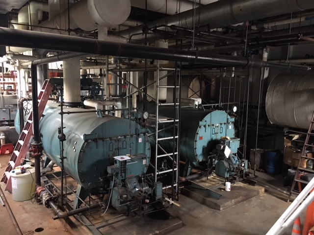 The gigantic original 1956 boilers are still in place. They are incredibly delicate and inefficient, and precariously keep the school heated …. most of the time.