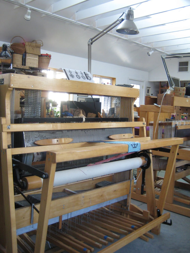The 16 harness loom was ordered soon after we moved to Murray, Kentucky, in 1976. I later tried to convert it to a computer-assisted loom, but it never worked reliably. So, it was turned back into a treadle loom.