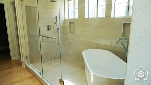 Walking shower with standalone bathtub. Beautiful turn out.