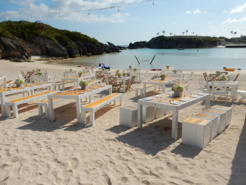 Dinner on a pink sand beach! - Our client didn't want a traditional table setting so we created bespoke tables and benches to enhance the look and feel of today's Bermuda.