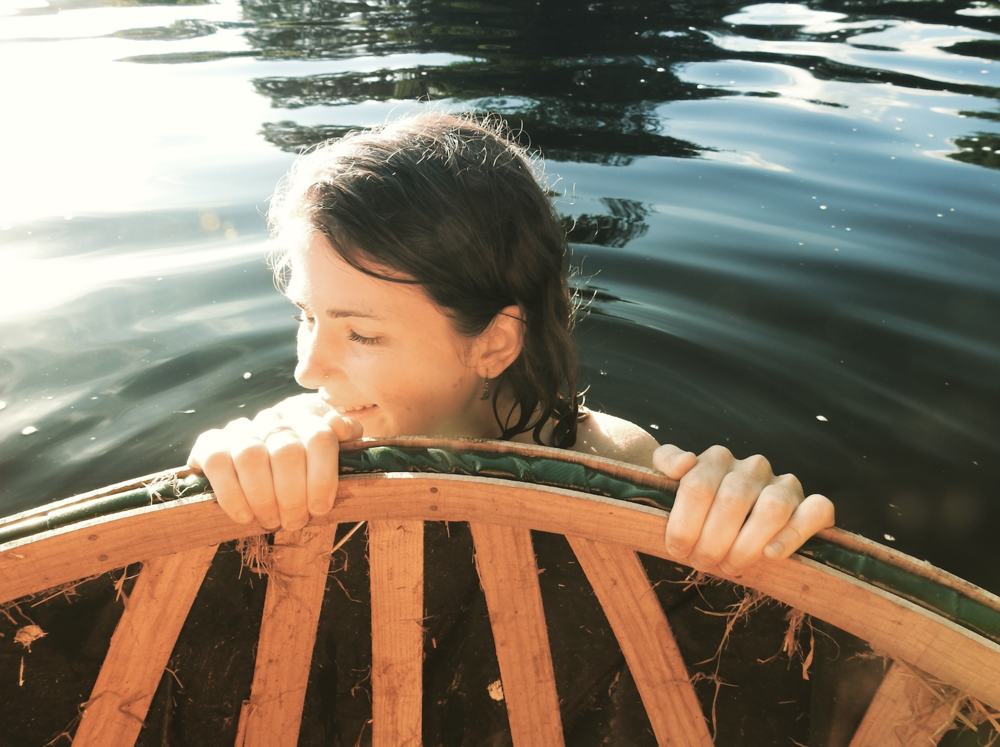 Floating down the River Dart with our handmade coracle