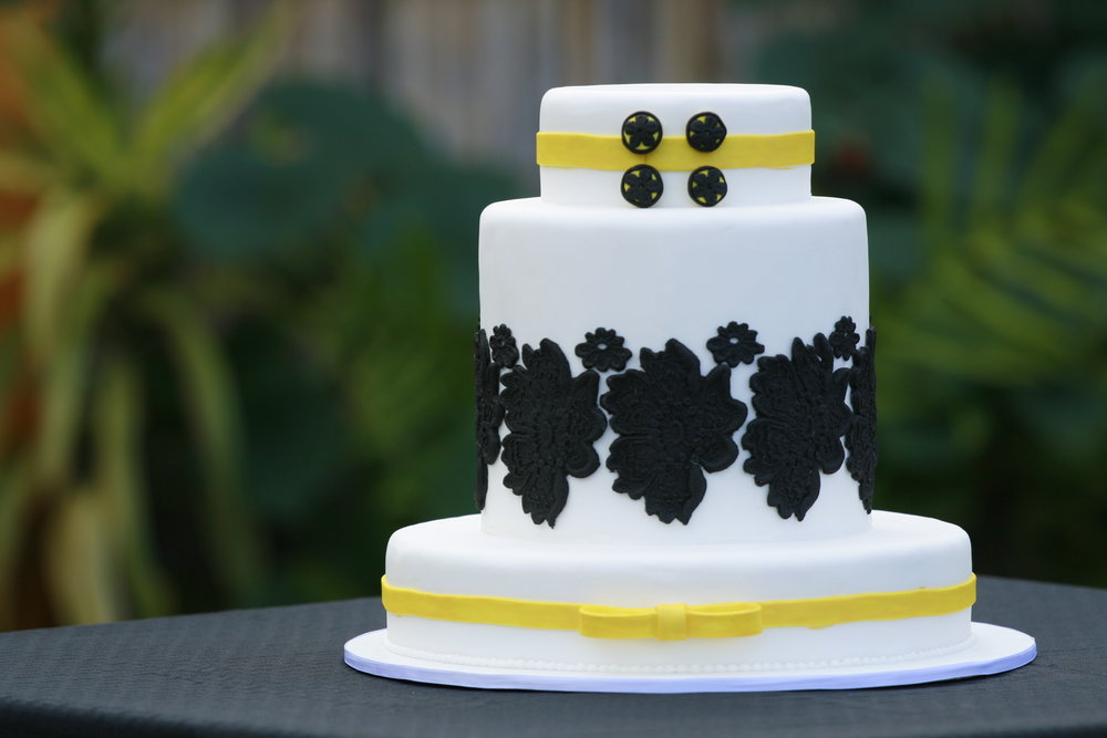 three tier round white rolled fondant wedding cake with edible black lace and buttons Hilo Hawaii Big Island Kailua-Kona