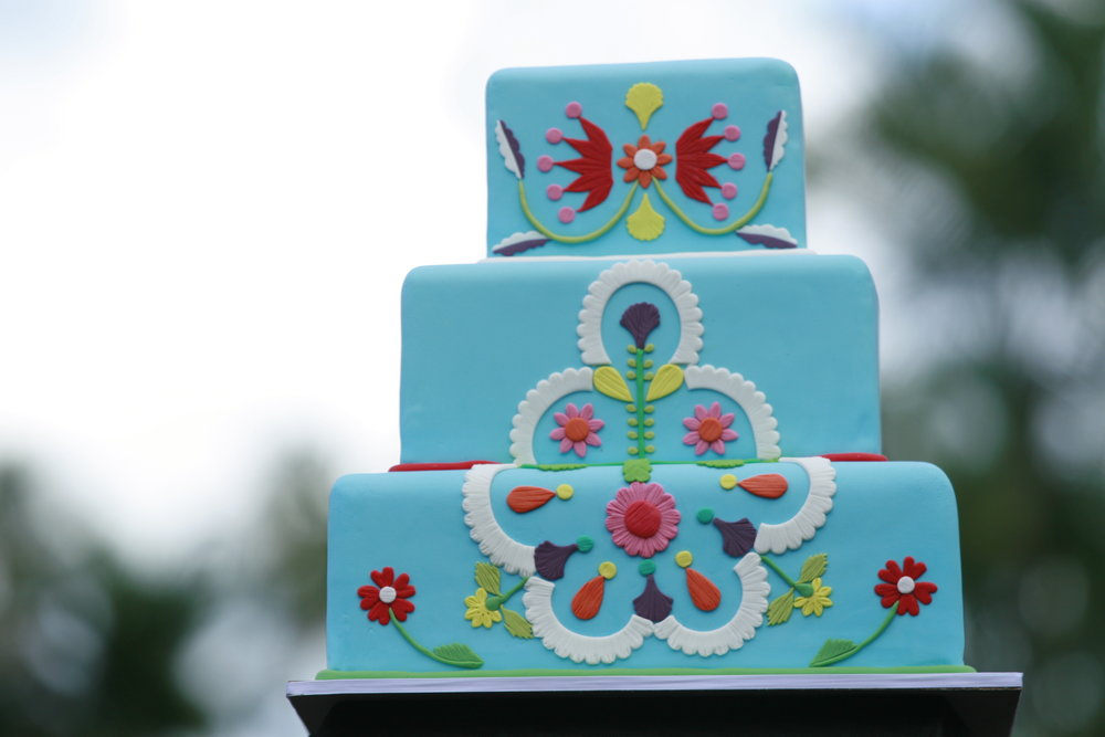 3 tier blue rolled fondant wedding cake with mexican fondant appliques
