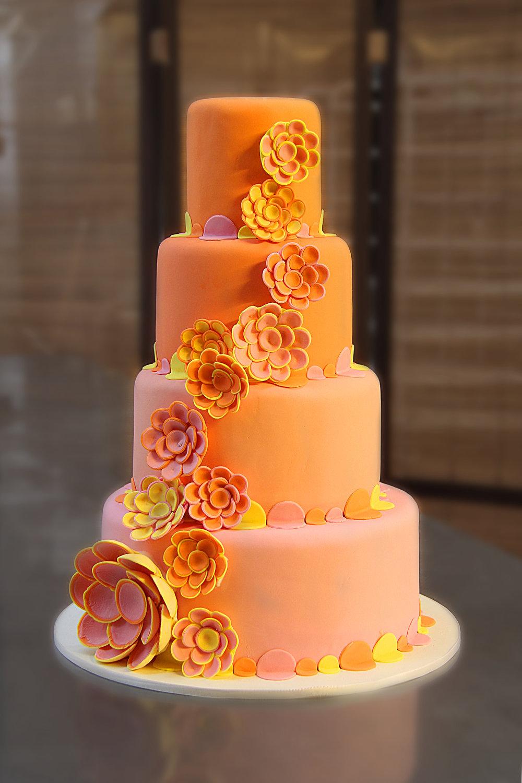 Four tier round peach ombre wedding cake Hilo Hawaii Big Island Kailua-Kona