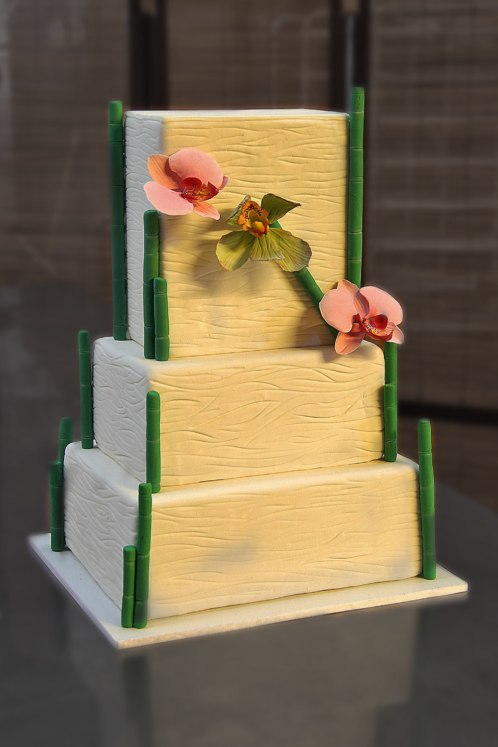 three tier rectangle white textured rolled fondant wedding cake with sugar bamboo and orchids Hilo Hawaii Big Island Kailua-Kona