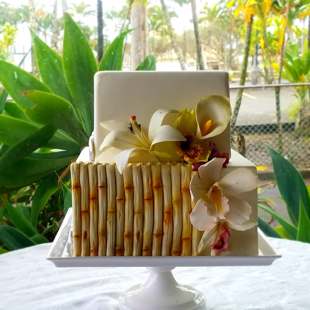 Copy of Two tier square rolled fondant cake with fondant bamboo sugar orchids calla lilies Hilo Hawaii Big Island Kailua Kona