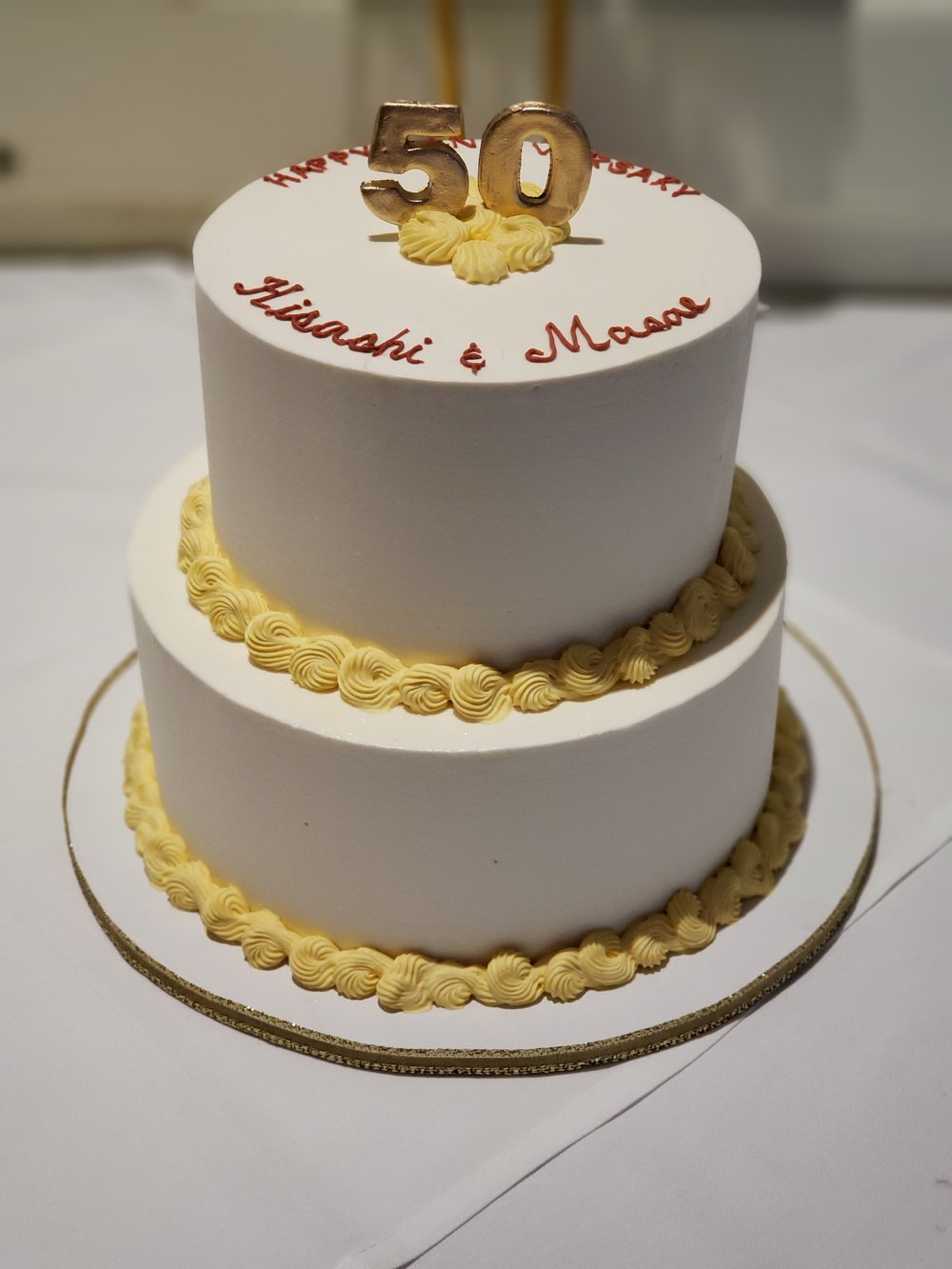 Two tier buttercream 50th anniversary cake with gold 50 topper Hilo Hawaii Big Island Kailua-Kona