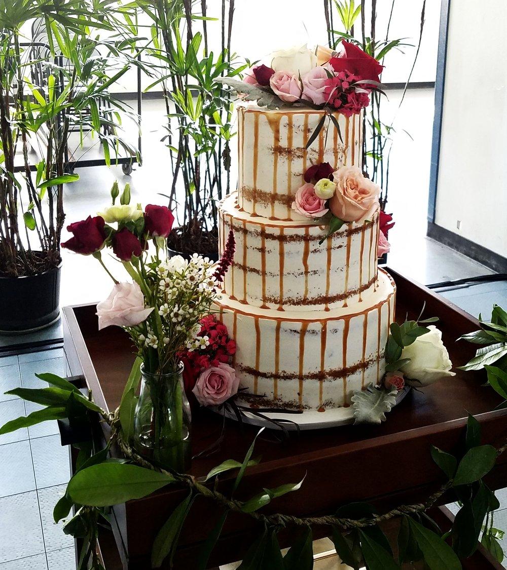 "Three tier ""naked"" buttercream wedding cake with caramel drip Hilo Hawaii Big Island Kailua-Kona"