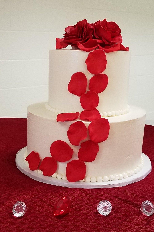 Two tier buttercream wedding cake with red sugar roses and petal cascade Hilo Hawaii Big Island Kailua-Kona
