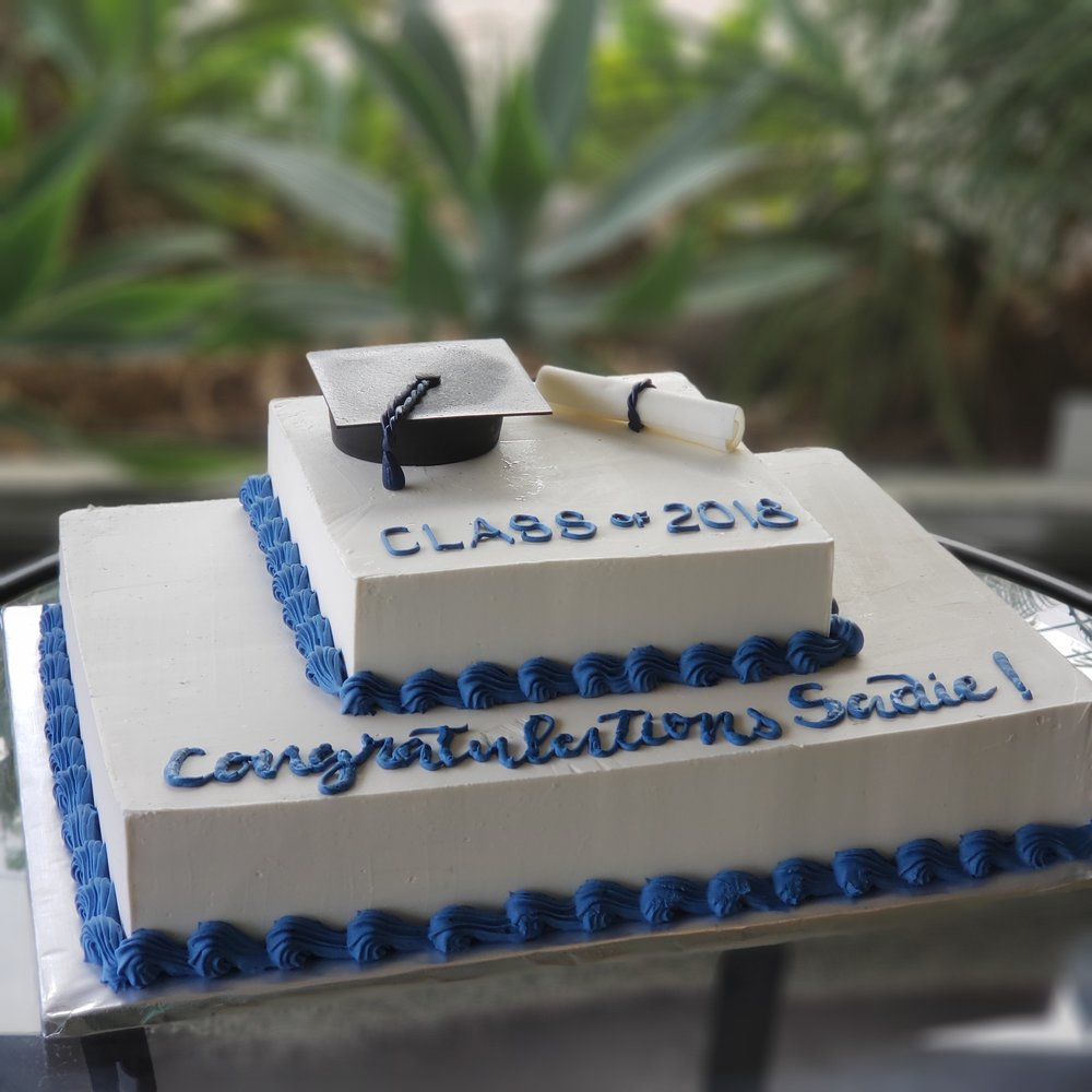 Two tier rectangle buttercream graduation cake with sugar graduation cap and diploma Hilo Hawaii Big Island Kailua Kona