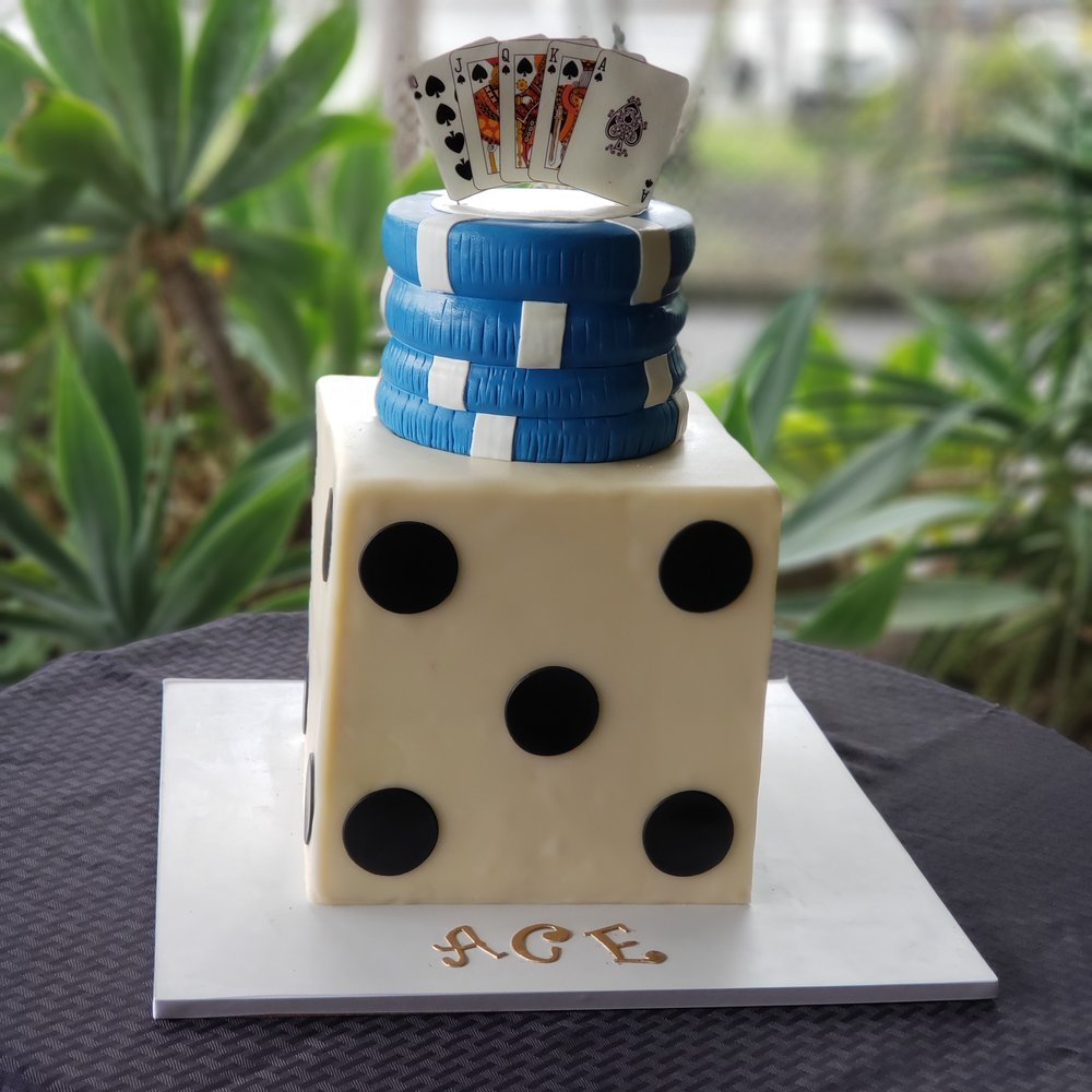 3D sculpted Las Vegas theme birthday cake with dice, poker chips and sugar playing cards topper Hilo Hawaii Big Island Kailua-Kona