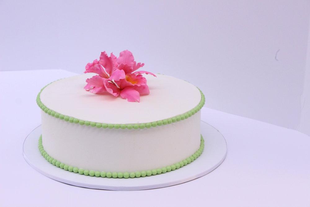 Single tier buttercream birthday cake with sugar orchids topper Hilo Hawaii Big Island Kailua-Kona