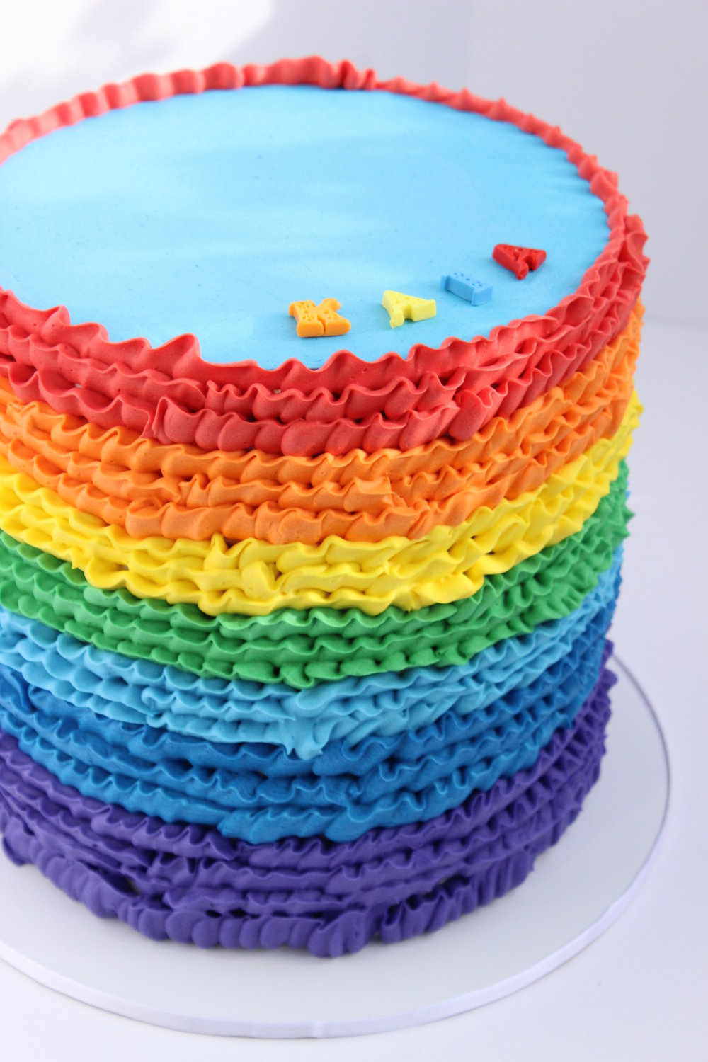 Copy of rainbow buttercream ruffled birthday cake Hilo Hawaii Big Island Kailua Kona
