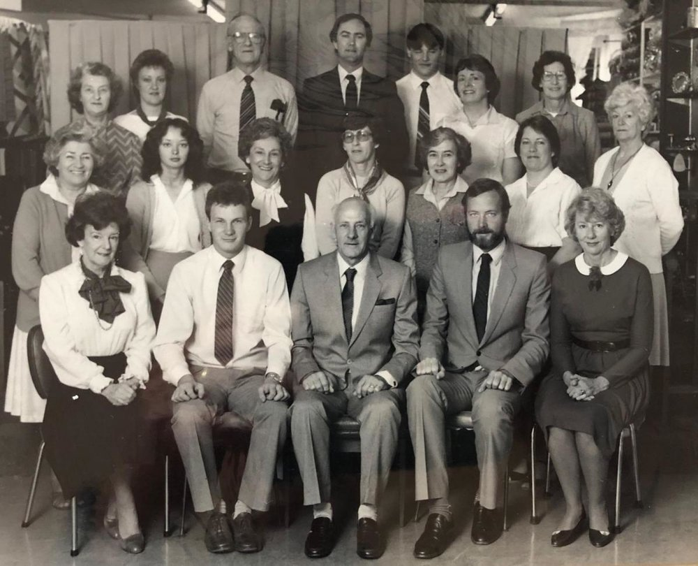 Home Fabrics staff photo from 1983. Gerald and Michael are in the front row with their father Jack.