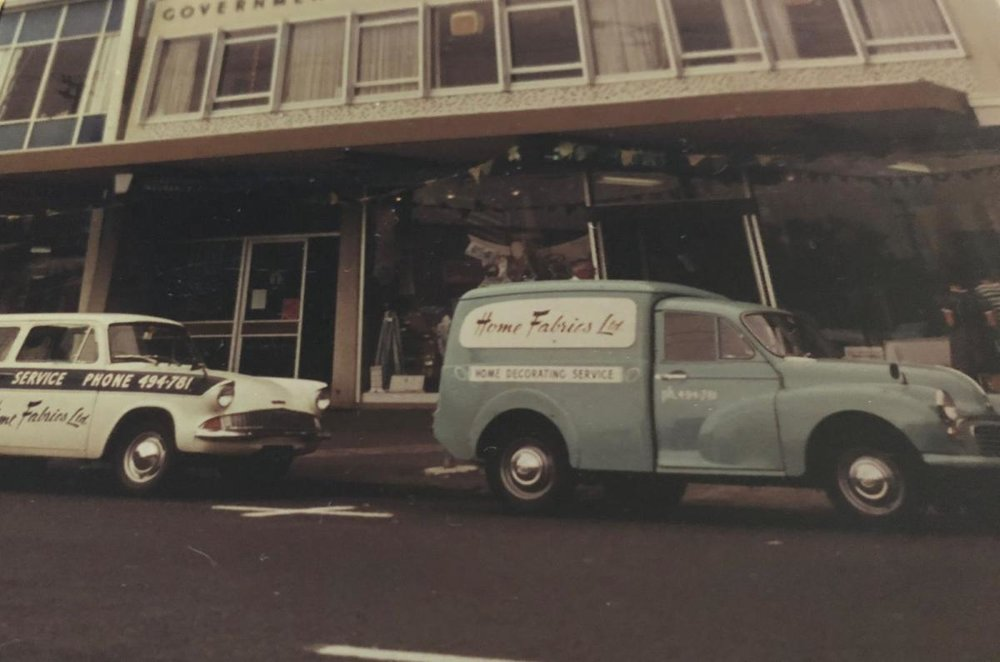 Home Fabrics vehicles outside the store in the 60s.