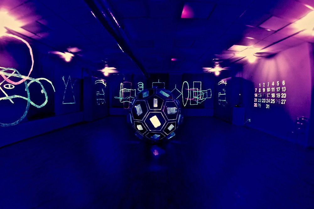 Dark Airing.  ArtStart Rhinelander November 15 2018-January 12 2019. Conserved packaging, black light, original soundtrack by Nathan Tolzmann. Photo: Nate Sheppard.