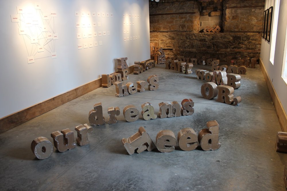 Our Words In/Out (after).  conserved corrugated cardboard, 2019.