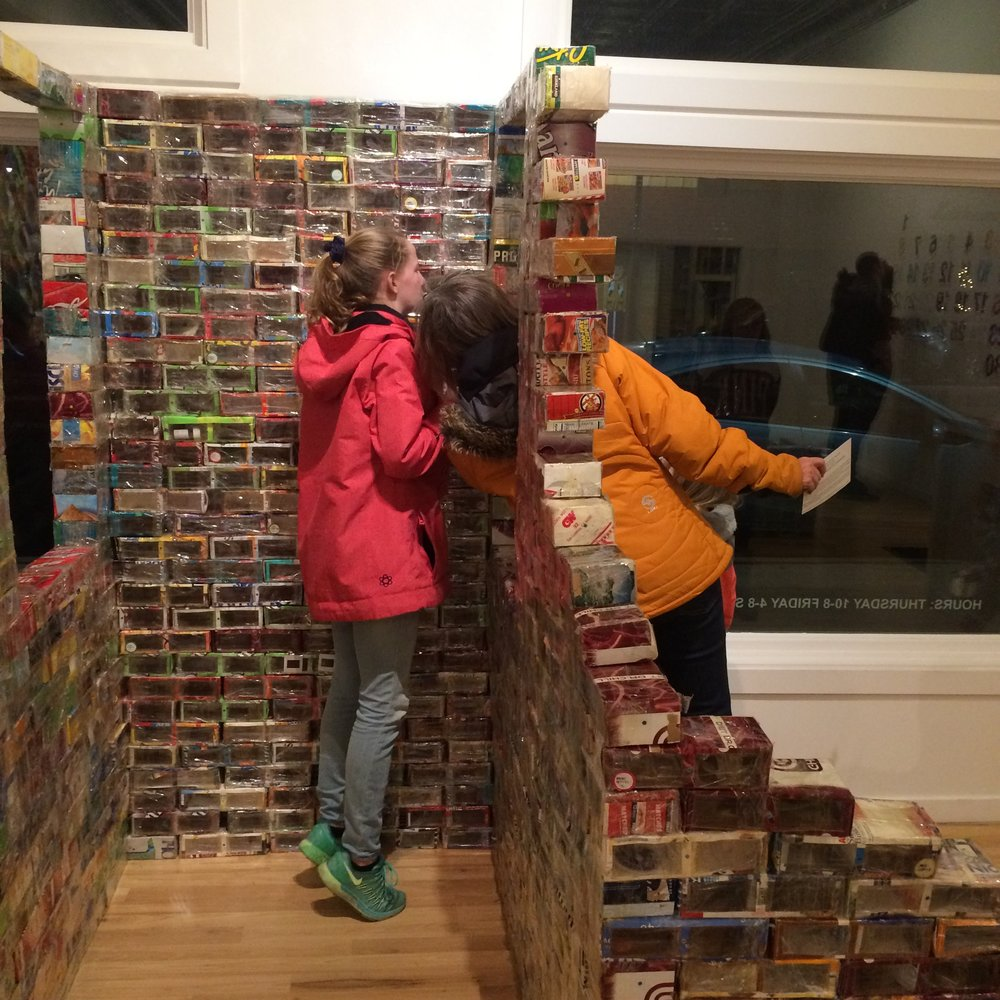 People choosing bricks at the opening reception for  From Below,  Lord Grizzly Gallery, Coffey Contemporary Gallery, January 05, 2019.