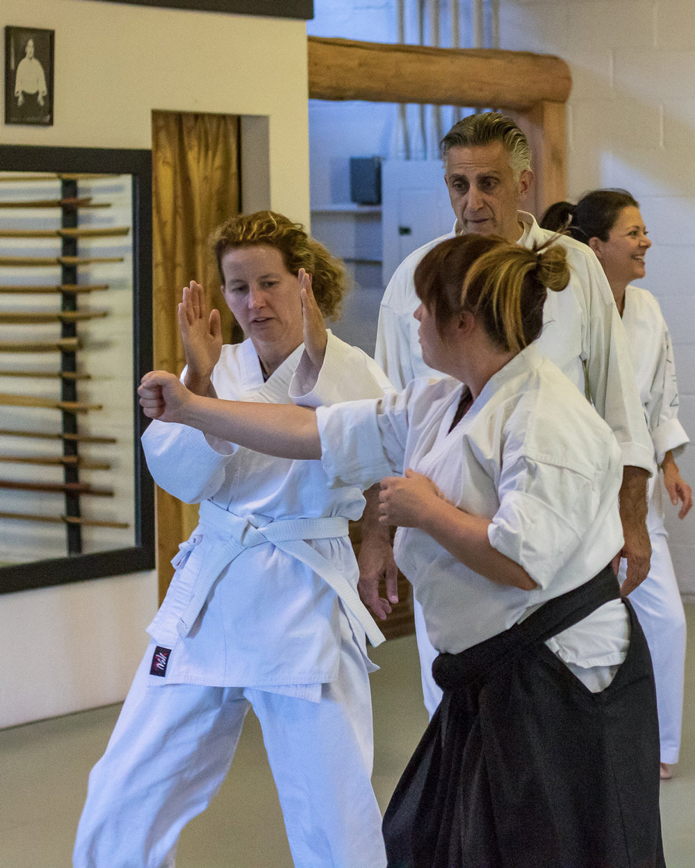 ADULT CLASS - Aikido is a martial art that goes about things in a totally unique way. You won't spend your valuable time becoming more combative and seeking out petty competition. In aikido, you'll learn to be expressive without being violent. While nonviolent in your practice, the power in your techniques will prove appropriate and effective to any situation which may arise.The philosophy is one of win-win.You'll work with the energy of the attack. The focus will be on self-defense and inner awareness. Skills you'll pick up range from eloquent verbal neutralization skills to gritty survival skills. All types of professionals can benefit. People from any walk of life can benefit. The best way to experience aikido is to schedule a time to visit the dojo and observe/attend a class.