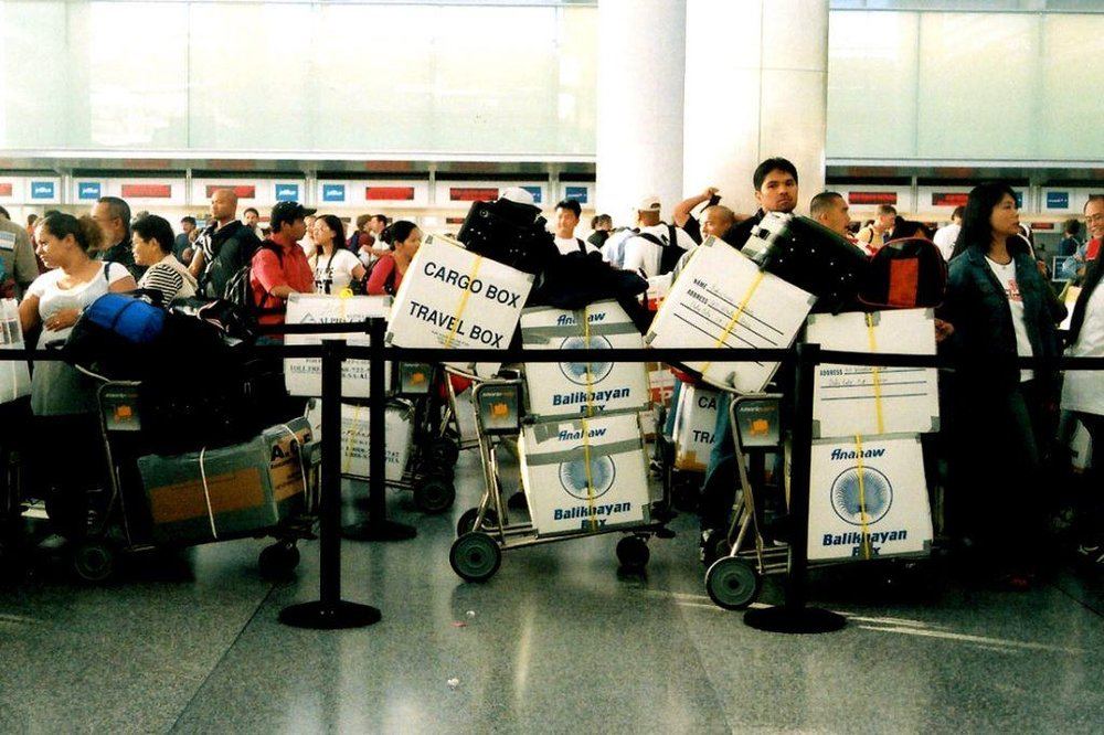 Fun fact about this photo —as I was researching information on balikbayan boxes, I came across this photo on Google of an impatient Filipino couple (on the right) at SFO bringing a load of balikbayan boxes with them to the Philippines. I then realized this scene looked so familiar and that the impatient couple are my own parents! This was a part of a trip my family and I took in 2007 when we traveled to the Philippines for the first time since my parents migrated to San Francisco—you can see part of my 9-year-old head behind the orange duffel bag. Apparently someone took this photo without our consent, but I personally think this is a wonderful photo regardless, and it only made me even more excited to pursue this personal project!