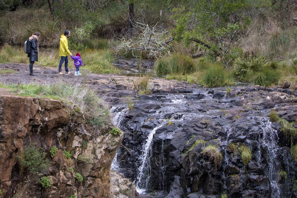 A casual walk along the tops of the falls, despite warnings of unstable cliffs, visitors frequent the upper rivers edge.