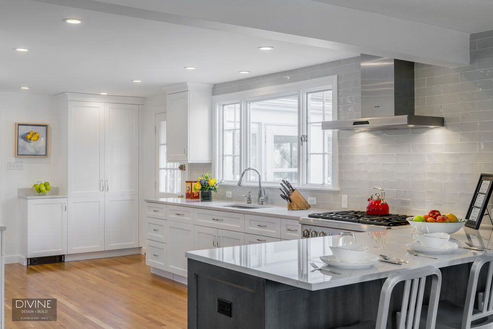 The marble subway tile here brings an upscale look to this beautiful transition kitchen and adds enough detail to visually break up the white upper and ... : kitchen-with-subway-tile - designwebi.com