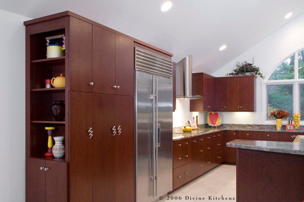 Modern Cherry Wood Cabinet Kitchen With Brushed Nickel Knobs. Marble  Countertops With Red And Pink