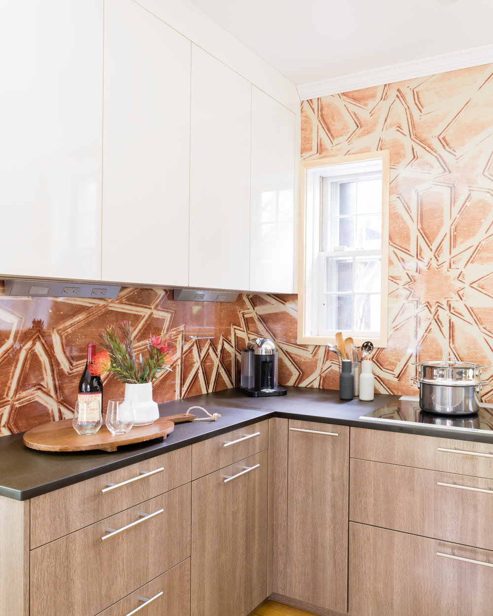 Moroccan style backsplash with oak veneer leicht cabinets in a modern kitchen. Wolf appliances, and a column wine fridge.