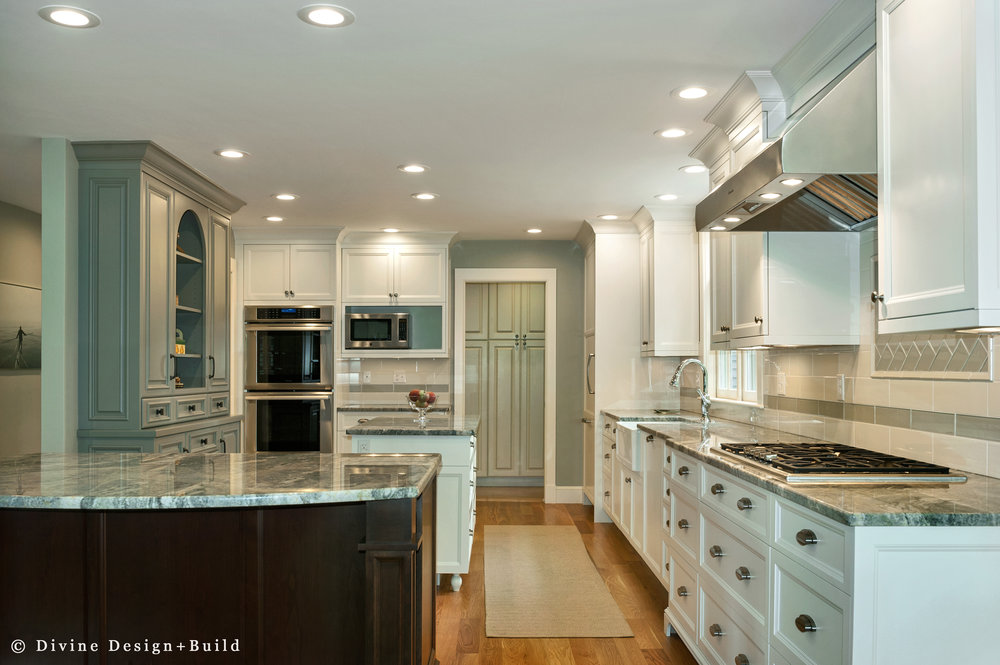 Transitional style kitchen with granite countertops and cool tones. Off white shaker cabinets.
