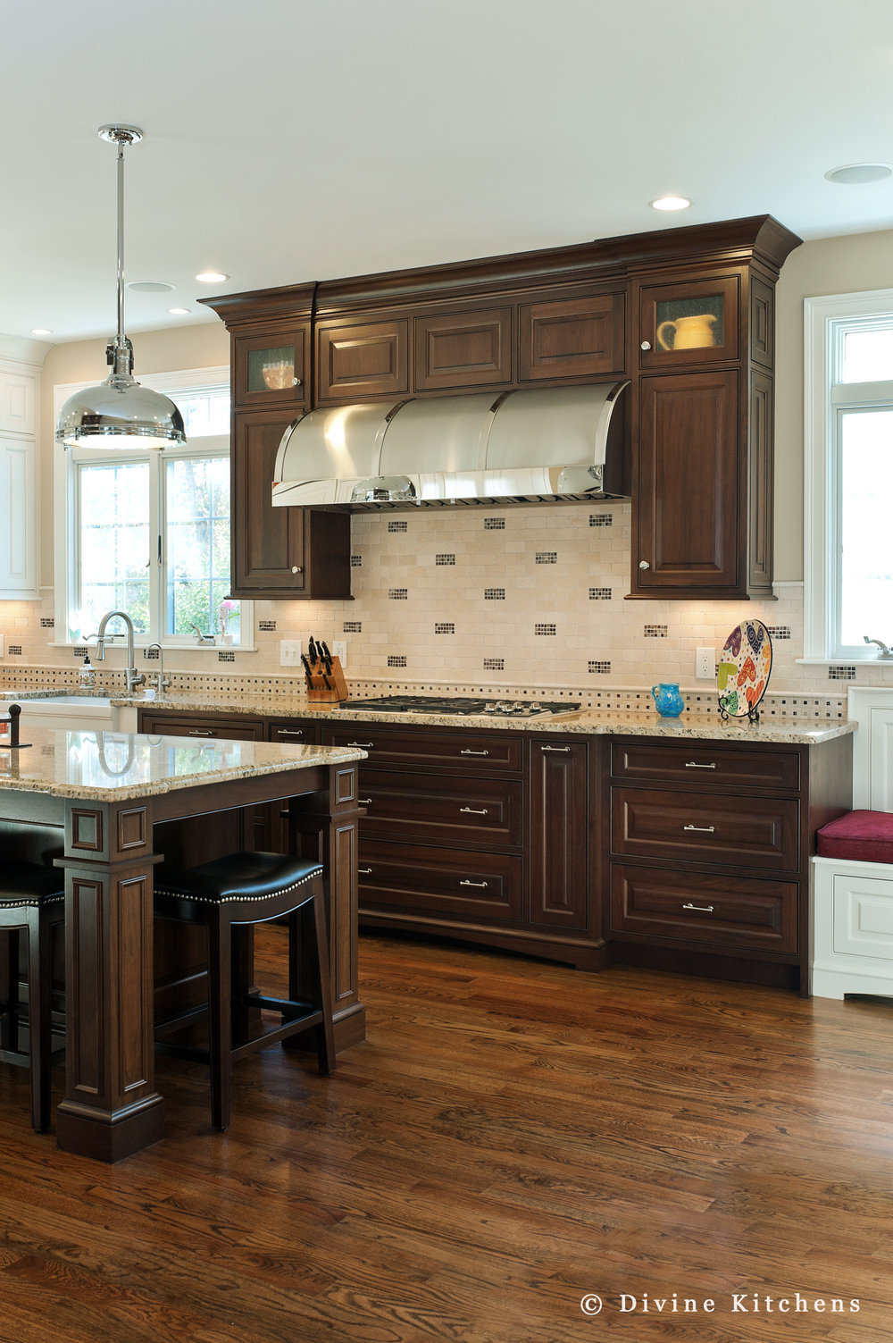 Large traditional kitchen with dark wood cabinets and mosaic tile backsplash