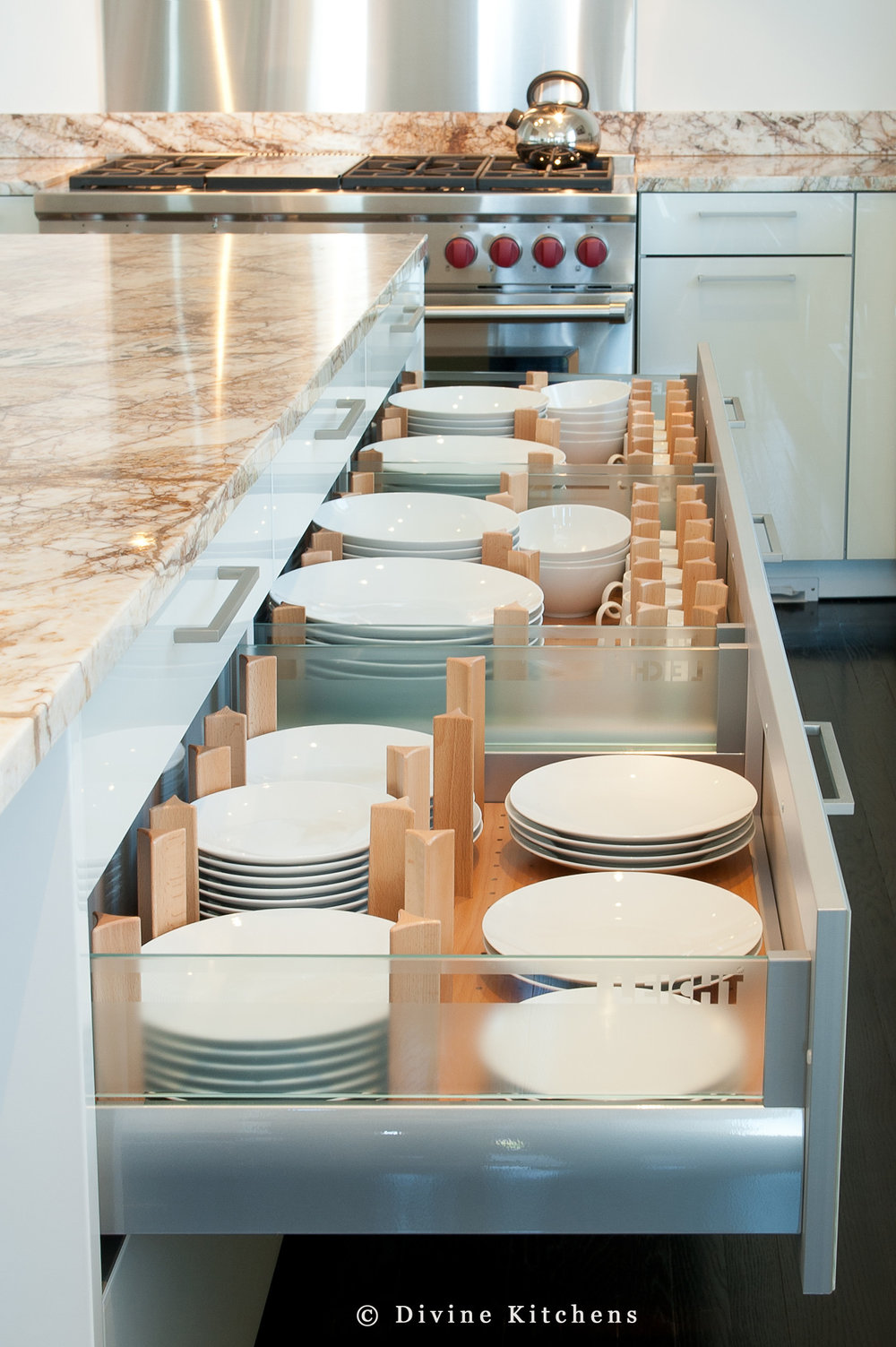 Modern leicht kitchen with high gloss lacquer cabinets. Marble countertops and wolf appliances. Interior drawer accessories of solid wood.