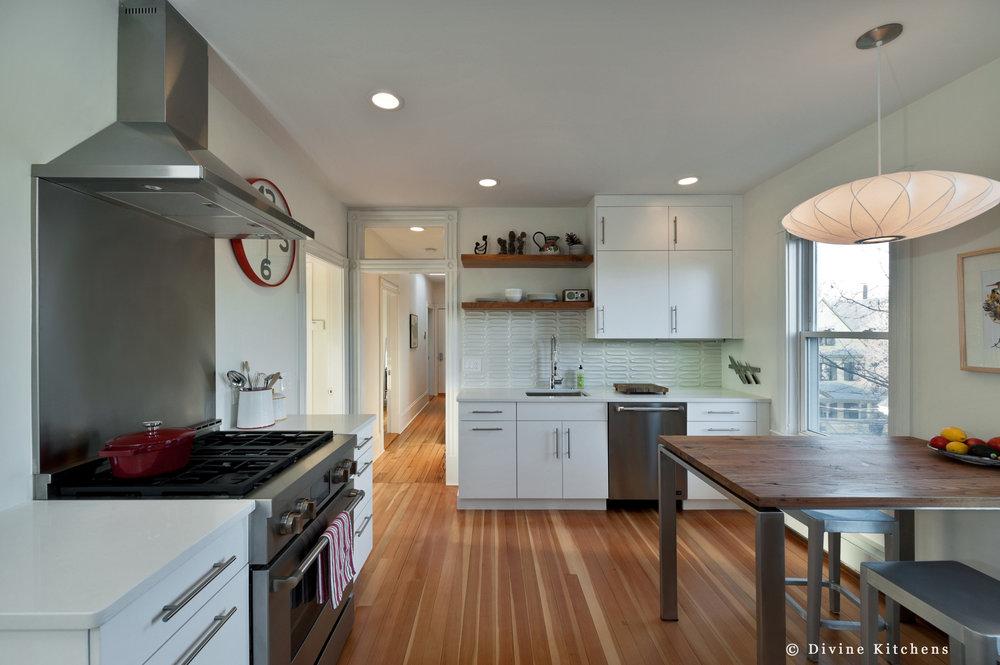 divine design center boston, transitional kitchen, cambridge kitchen, kitchen renovation boston, paneled refrigerator, white shaker style cabinets, stainless steel cabinet handles, hampshire kitchen cabinets