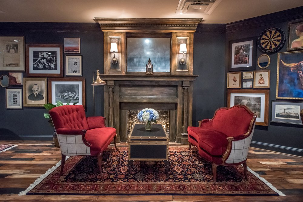the parlor - The Parlor consists of an elevated, semi-private lounge featuring a candlelit fireplace, rich leather chairs and mahogany game tables. There are also two televisions for easy viewing.35 Reception